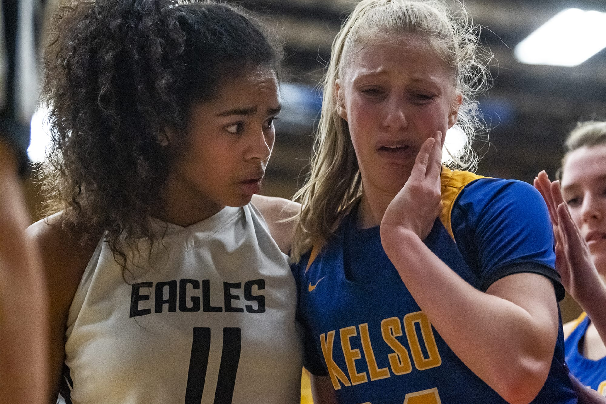 Hudson's Bay's Jaydia Martin, left, checks on Kelso's Natalie Fraley after Fraley was hit in the face on a drive during a game at Mountain View High School on Friday night, Feb. 7, 2020. (Nathan Howard/The Columbian)