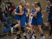 Kelso celebrates their win over Hudson's Bay during a game at Mountain View High School on Friday night, Feb. 7, 2020.