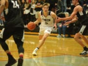Union senior Tanner Toolson finds a lane against Kentlake at Union High School on Tuesday, January 21, 2020.