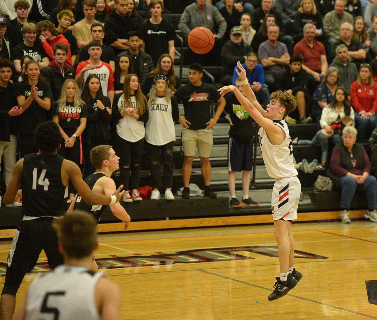 Union junior Kaden Horn shoots a deep three pointer against Kentlake at Union High School on Tuesday, January 21, 2020.