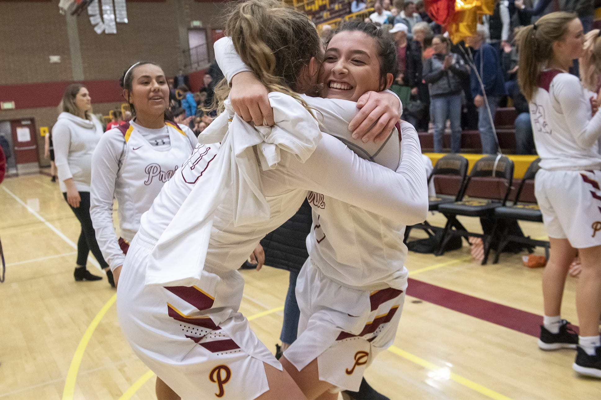 Prairie's Claire Heitschmidt, left, and Dayna Vera celebrate their win over Yelm Prairie High School on Friday night, Feb. 14, 2020. (Nathan Howard/The Columbian)