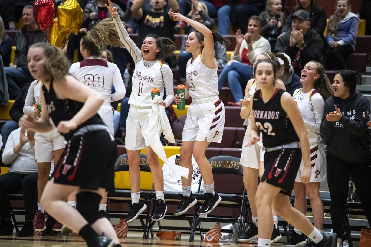 The Prairie bench reacts to a three during a game against Yelm at Prairie High School on Friday night, Feb. 14, 2020. (Nathan Howard/The Columbian)