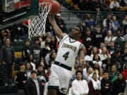 Evergreen's Zyell Griffin goes up for a dunk vs. Peninsula in a winner-to-state game in the 3A boys basketball bi-district tournament on Saturday night, Feb. 15, 2020.