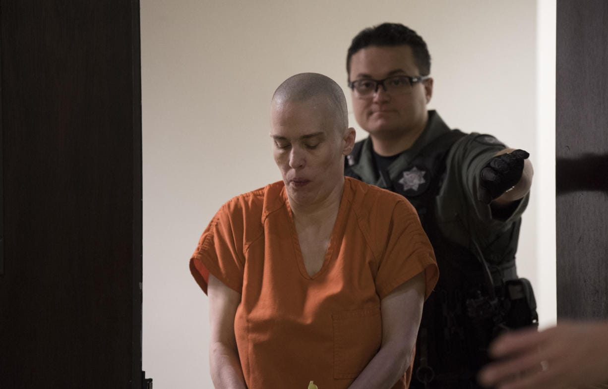 Rima L. McQuestion, 44, leaves the courtroom after appearing Thursday in Clark County Superior on suspicion of first-degree assault, a potential charge stemming from an alleged knife attack that left her sister hospitalized with life-threatening injuries.