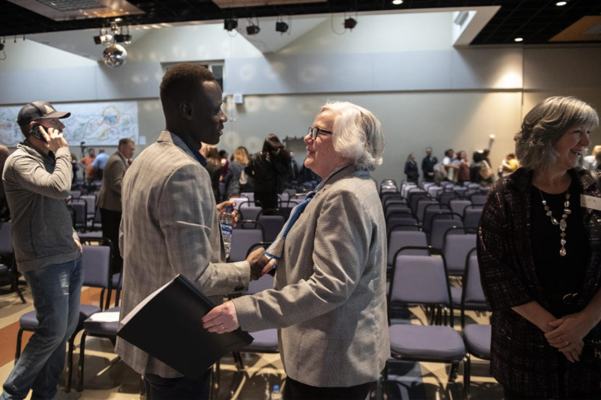 Evan Kamme, left, president of the Associated Students of Clark College, greets Sandra Fowler-Hill, interim president of Clark College, following the 2020 State of the College address at Clark College on Wednesday. Fowler-Hill's speech reflected on the challenges of the last year while looking forward with optimism at the future of the college.
