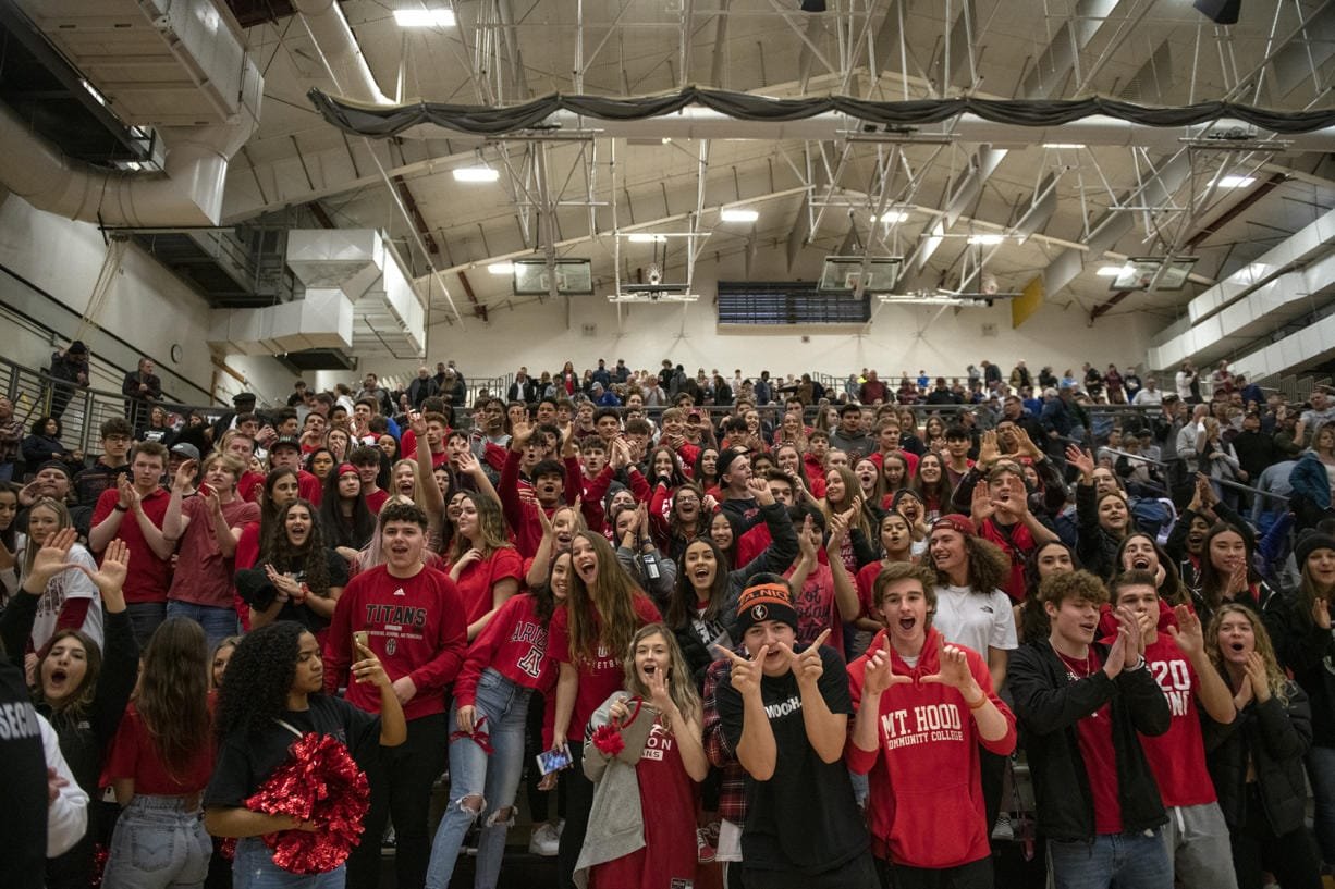 Union High School's student section celebrates their team's win over Gonzaga Prep at Battle Ground High School on Saturday evening, Feb. 29, 2020. (Zach Wilkinson/for The Columbian)