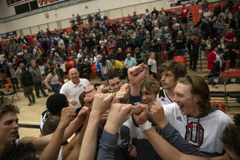 The Union Titans celebrate their victory over the Gonzaga Prep Bullpups at Battle Ground High School on Saturday evening, Feb. 29, 2020. (Zach Wilkinson/for The Columbian)