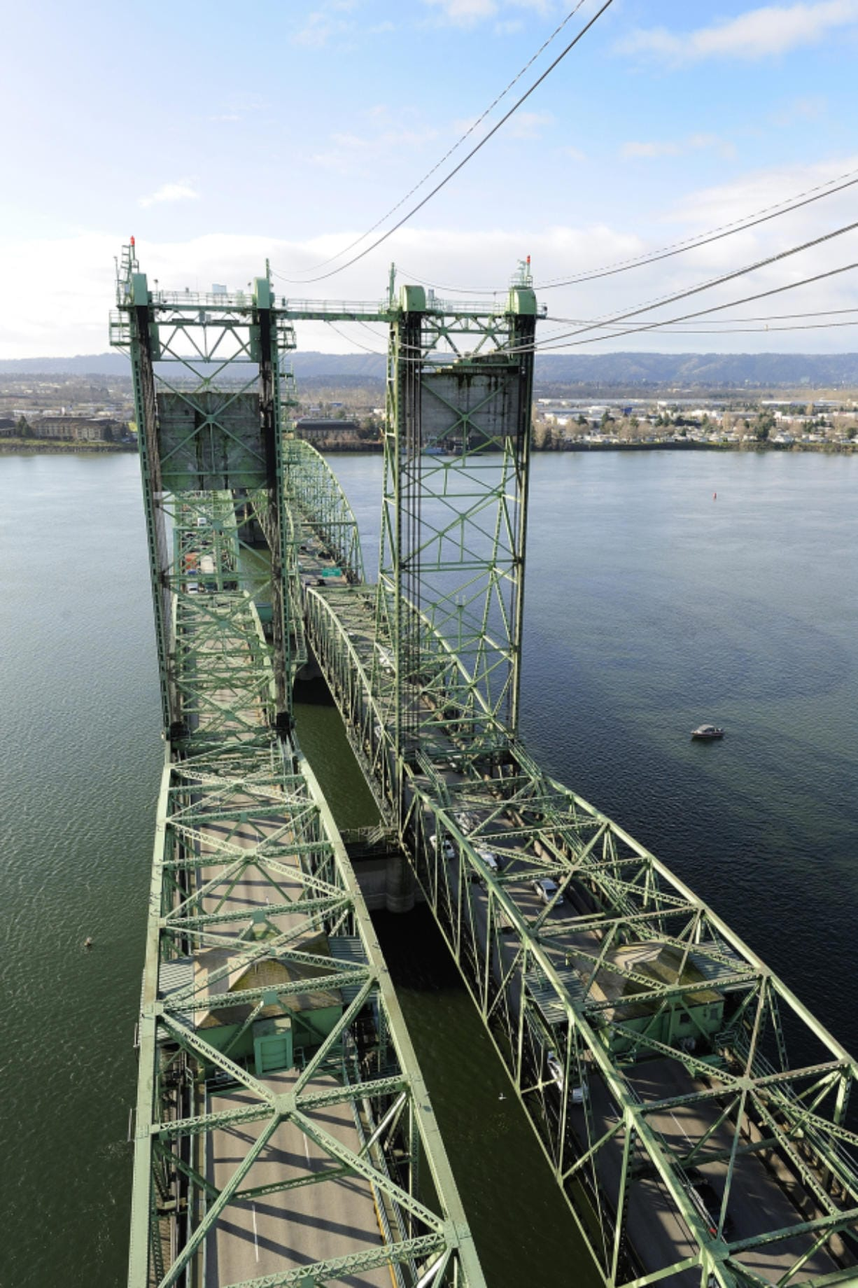 In September, Hamilton Construction Co. of Springfield, Ore., will replace several components of the Interstate 5 Bridge's lifting mechanism for the northbound span, which can be seen to the left in this photo looking south toward Oregon. (Columbian files)