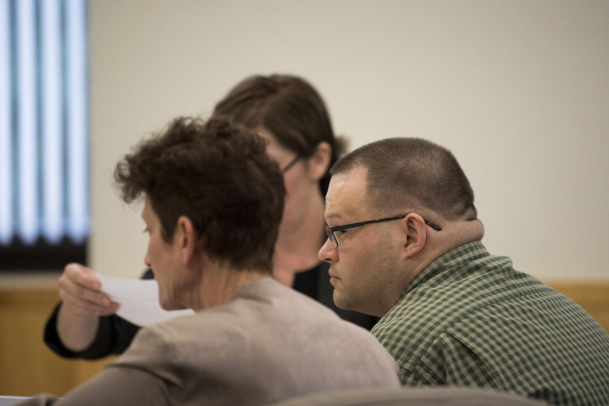 Ryan M. Burge, right, who stands accused of killing his then-girlfriend's 5-year-old daughter, Hartley Anderson, listens to opening statements in his trial in Clark County Superior Court on Tuesday afternoon, Feb. 4, 2020. (Amanda Cowan/The Columbian)