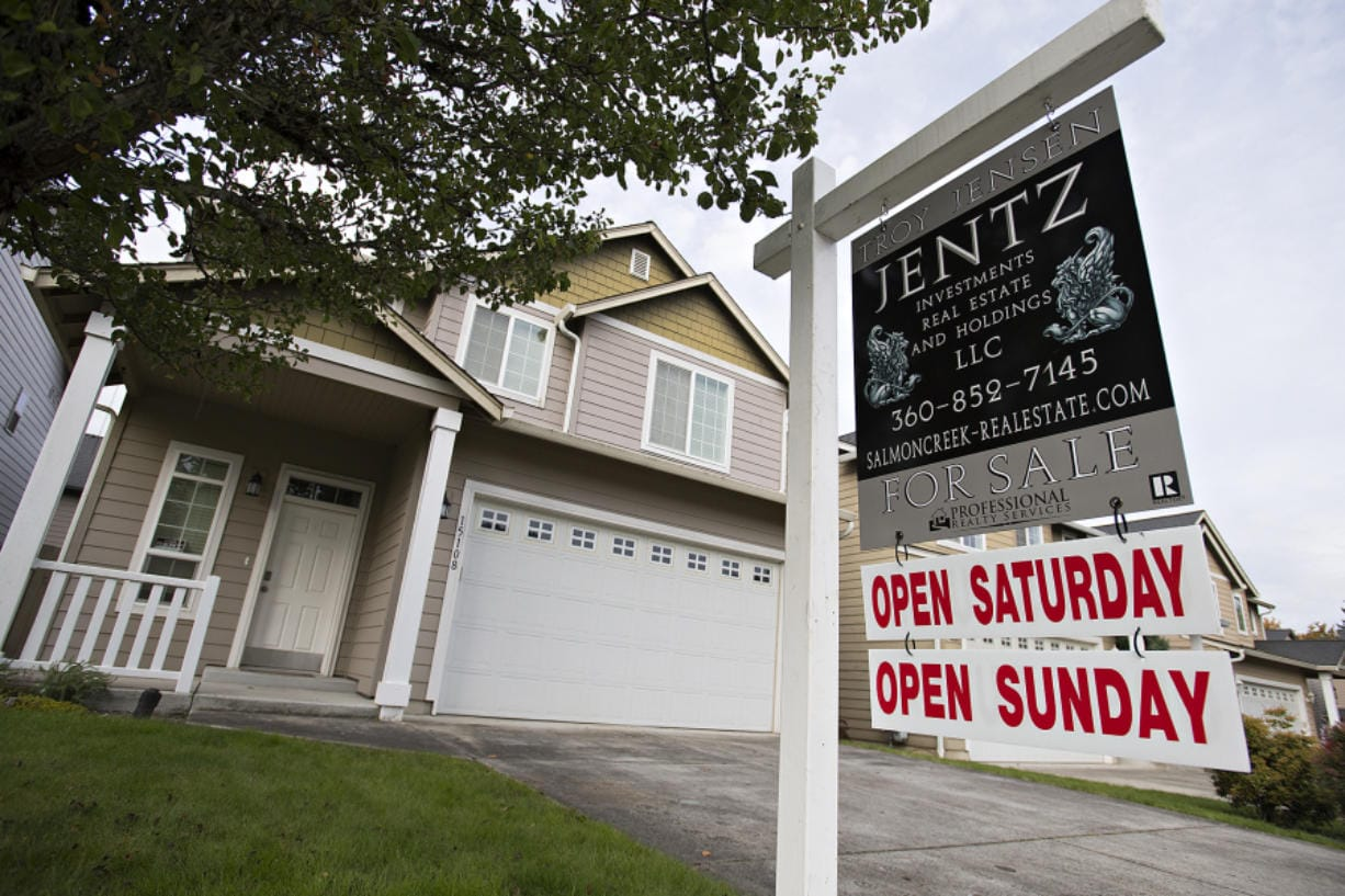 A sign lists a home for sale in Salmon Creek in October. After a seasonal slump in November and December, the Clark County residential housing market saw a jump in listing and sales activity in January.