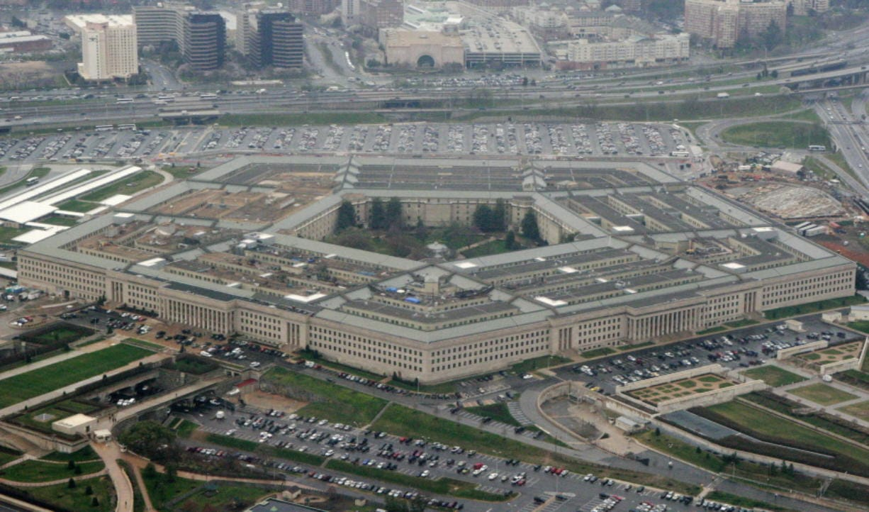 FILE - This March 27, 2008, aerial file photo, shows the Pentagon in Washington. A Federal court has ordered the Pentagon to temporarily halt work with Microsoft on its $10 billion military cloud contract, Thursday, Feb. 13, 2020, after Amazon sued alleging that President Donald Trump's bias against the company hurt its chances to win the project.  Amazon requested the court issue the injunction last month. Both the documents requesting the block and the judge's decision to issue the temporary injunction are sealed by the court.