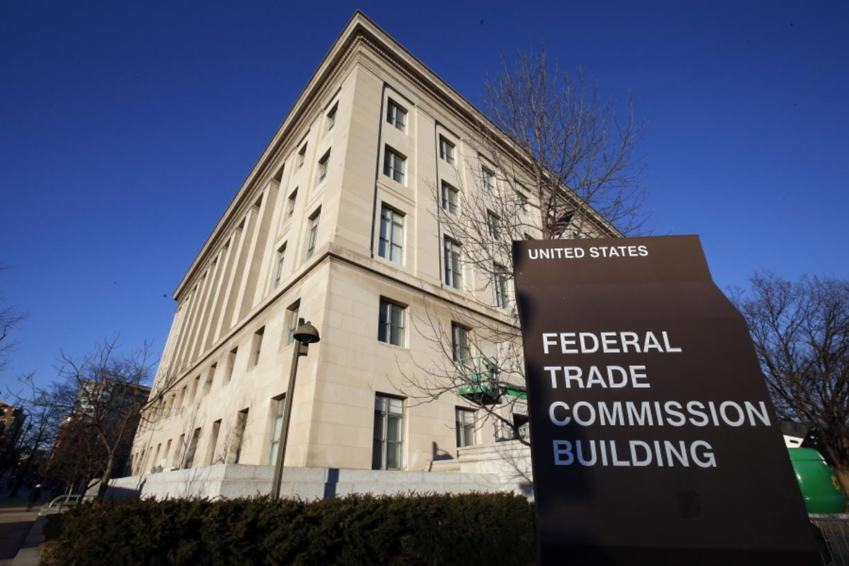FILE - This Jan. 28, 2015, file photo, shows the Federal Trade Commission building in Washington. Federal regulators are amping up their investigation of the market dominance of five giant tech companies, demanding detailed information on their acquisitions back to 2010.  The Federal Trade Commission announced the move Tuesday, issuing orders to Facebook, Amazon, Apple, Microsoft and Google's parent Alphabet Inc.