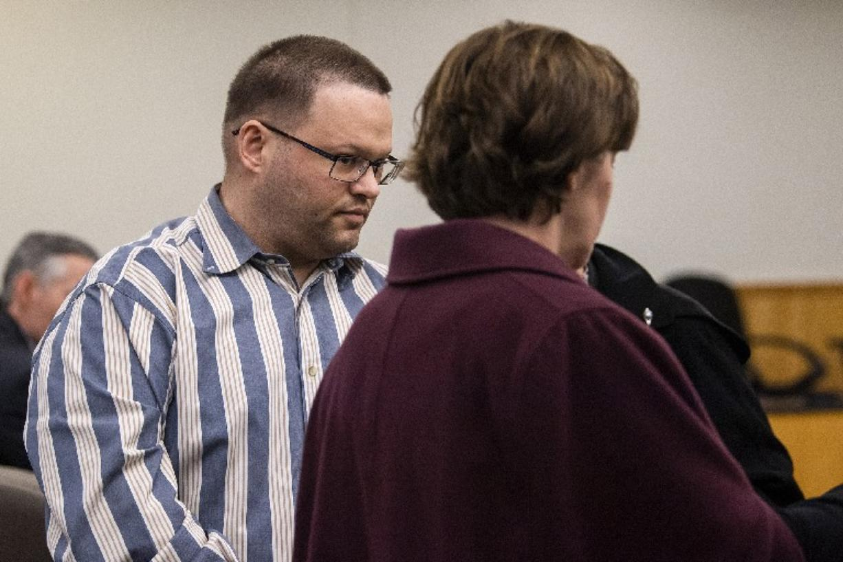 Ryan M. Burge, right, who stood accused of killing his then-girlfriend's 5-year-old daughter, Hartley Anderson, enters the courtroom for the verdict at Clark County Superior Court in Vancouver on Thursday. The jury convicted Burge of second-degree murder but was undecided on a charge of first-degree murder. (Alisha Jucevic/The Columbian)