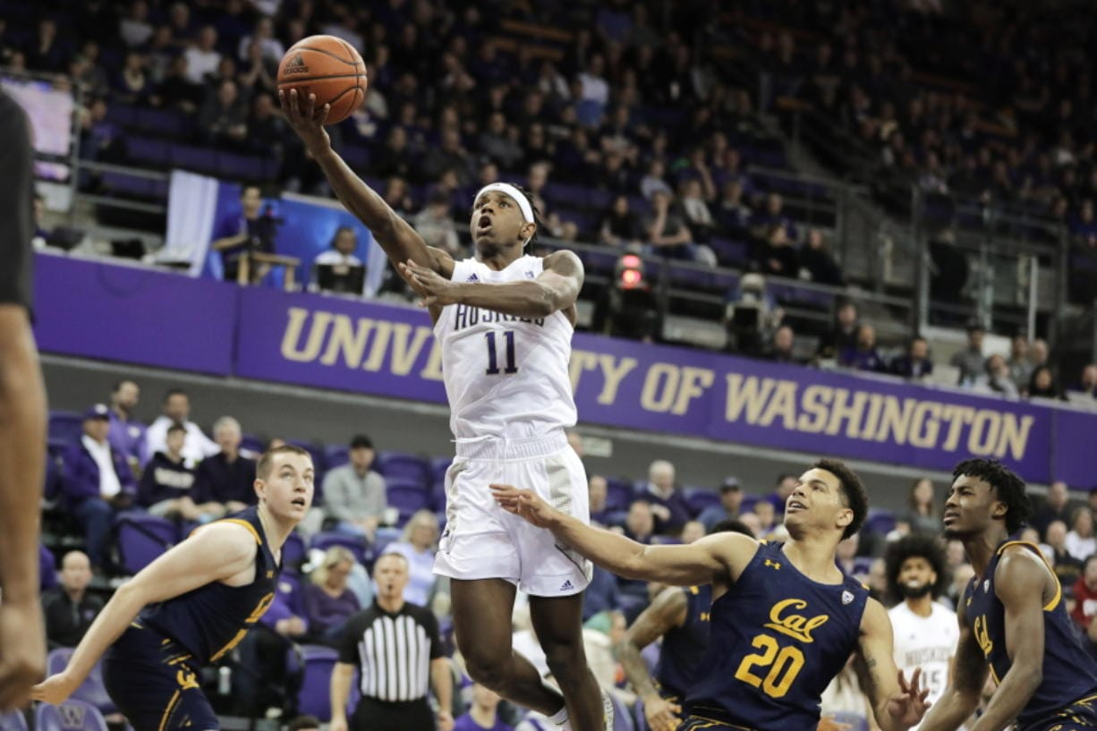 Washington guard Nahziah Carter (11) shoots above California guard Matt Bradley (20) during the first half of an NCAA college basketball game Saturday, Feb. 22, 2020, in Seattle. (AP Photo/Ted S.