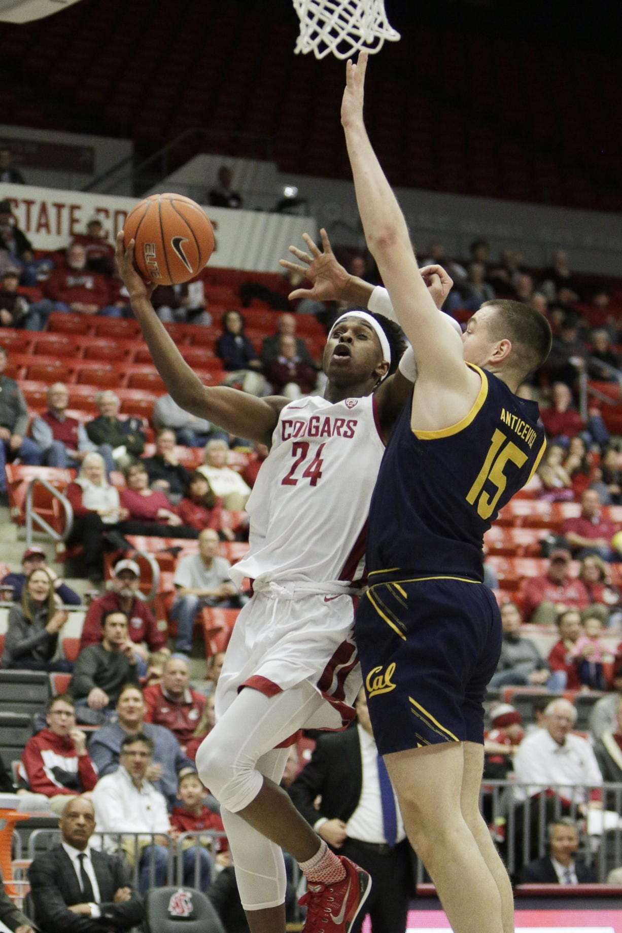 Washington State guard Noah Williams (24) is fouled by California forward Grant Anticevich (15) on a drive to the basket during the first half of an NCAA college basketball game in Pullman, Wash., Wednesday, Feb. 19, 2020.