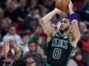 Boston Celtics forward Jayson Tatum shoots against the Portland Trail Blazers during the second half of an NBA basketball game in Portland, Ore., Tuesday, Feb. 25, 2020.