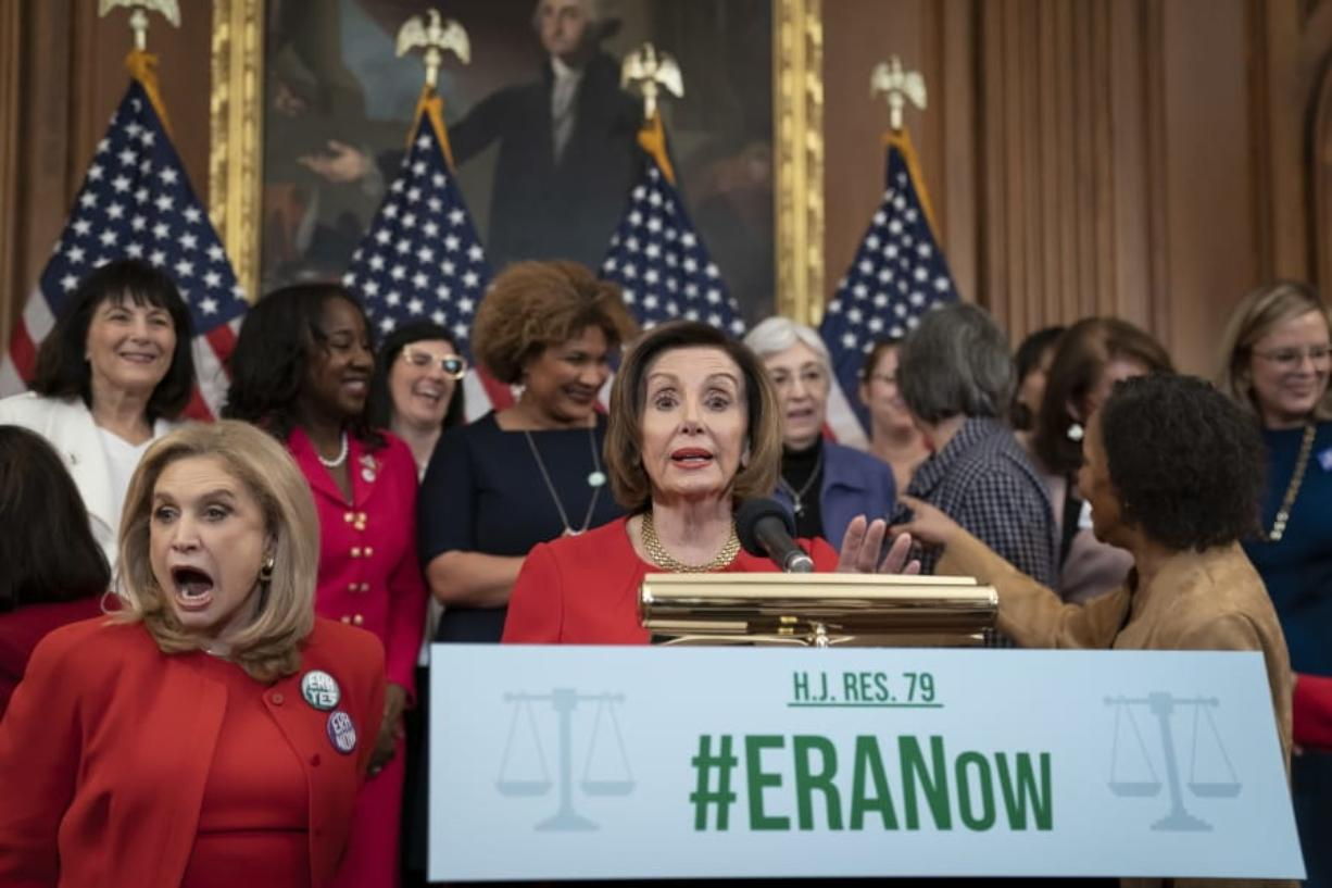 Speaker of the House Nancy Pelosi, D-Calif., joined at left by Rep. Carolyn Maloney, D-N.Y., and other congressional Democrats, holds an event about their resolution to remove the deadline for ratification of the Equal Rights Amendment, at the Capitol in Washington, Wednesday, Feb. 12, 2020. (AP Photo/J. Scott Applewhite)