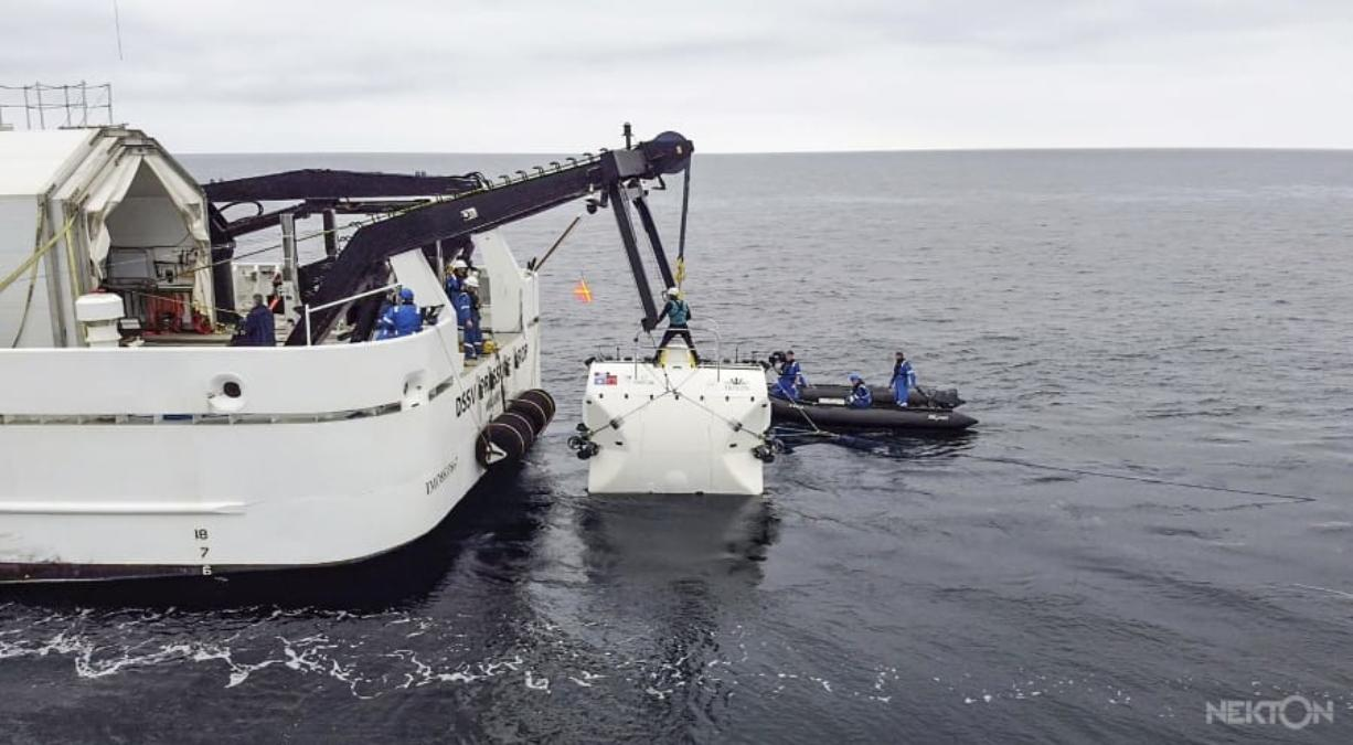 """In this handout photo taken in Jan. 2020 and provided by Nekton, scientists lower the """"Limiting Factor"""" submarine into the Mediterranean Sea, part of sea trials before the next stage of the Nekton Mission begins in mid-March. A team of scientists is preparing to dive deep into the depths of the Indian Ocean - into a """"Midnight Zone"""" where light barely reaches, but life still thrives. Scientists from the British-led Nekton Mission plan to survey wildlife and gauge the effects of climate change in the unexplored area. (Nekton via AP) (Nekton)"""