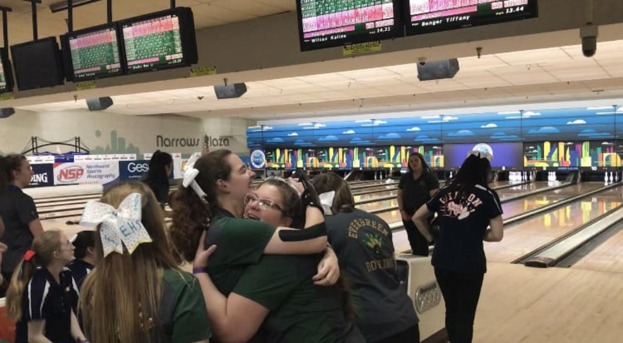 Evergreen's Karina Johnson (left) and Kierra Wilcox celebrate the team's monster fifth game Friday at the 3A state bowling tournament. The Plainsmen rolled a 1,004-pin fifth game and have a 167-pin team lead entering Saturday.