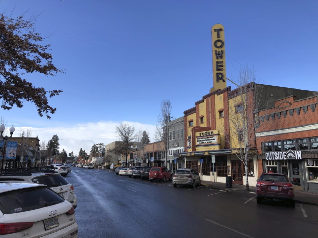This Jan. 28, 2020 photo shows the Tower theatre located in downtown Bend, Ore., where the population in the early 1990's was around 25,000 and leaned Republican. Demographic shifts are helping push the Republican Party into a nosedive along the West Coast. The last Republican presidential candidate that California went for was George H.W. Bush. For Oregon and Washington, it was Ronald Reagan. Now, Republicans in the three states are even struggling to hold seats in Congress, statehouses and city councils.
