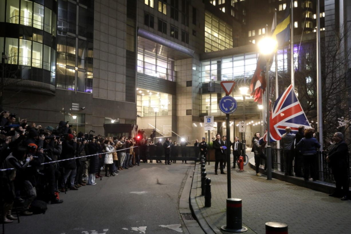 FILE - In this Jan. 31, 2020 file photo, Britain's Union flag is removed from outside of the European Parliament in Brussels.  The bloc has been preoccupied for almost four years with Brexit, but now that Britain has left the bloc, the EU hopes to find more time to fix its own problems.