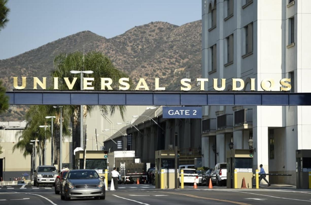 """FILE - In this Aug. 23, 2016 file photo, the entrance to the Universal Studios lot is pictured in Universal City, Calif. A film built around the premise of liberal """"elites"""" hunting people for sport in red states is coming to theaters in March, and the studio behind it is leaning into controversy about its premise. Universal Pictures on Tuesday, Feb. 11, 2020,  unveiled a trailer announcing """"The Hunt"""" will be released March 13, roughly six months after it was supposed to have been released.   (Photo by Chris Pizzello/Invision/AP, File) (Universal Pictures)"""