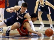 Gonzaga forward Filip Petrusev (3) collides with Pepperdine guard Keith Smith (11) during the first half of an NCAA college basketball game Saturday, Feb. 15, 2020, in Malibu, Calif. (AP Photo/Ringo H.W.