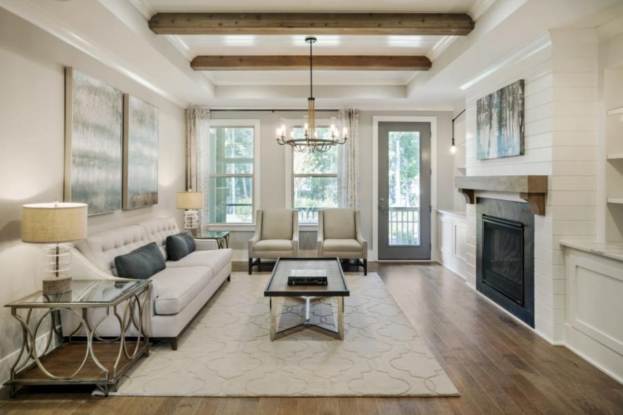 This photo provided by Ashton Woods shows a residential family room with natural wood beams as part of the ceiling in the Ashton Woods GlenPark community in Raleigh, N.C.