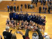 The Elma girls basketball team poses in front of its fans after beating La Center 66-40 in the 1A district championship game Wednesday at Rochester High School.