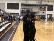 Hudson's Bay junior Kamelai Powell is embraced by her father, Kenan Powell, after the Eagles beat Meadowdale 55-49 on Saturday in the 3A state regionals at Issaquah.