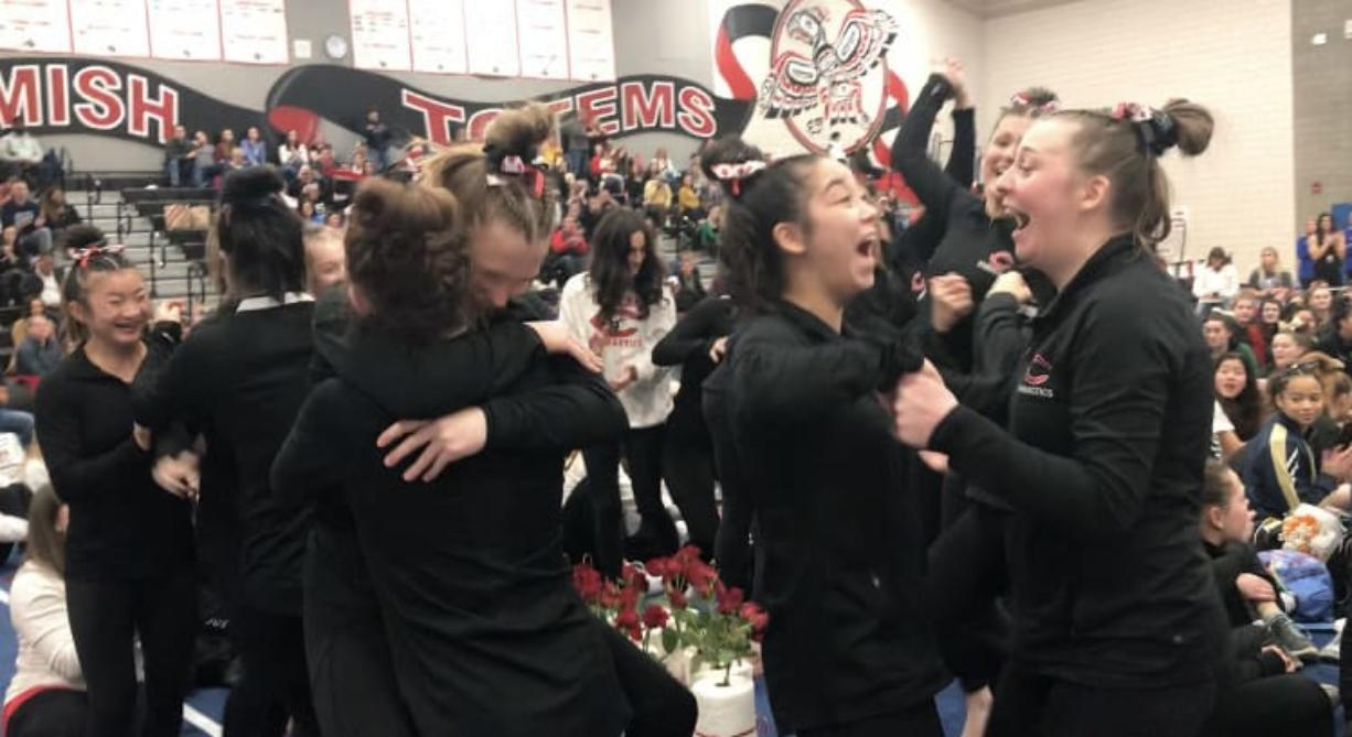 Camas High gymnasts celebrate after winning the WIAA 4A state title on Friday, Feb. 21, 2020, at Sammamish High School. It was their third state championship.
