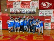 The La Center wrestling team celebrates its 50-28 win over Castle Rock on Tuesday, Jan.