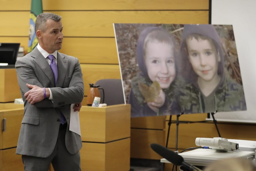 Ted Buck, an attorney for Chuck and Judy Cox, the parents of missing Utah woman Susan Cox Powell and the grandparents of Susan's sons Charlie and Braden, who were attacked and killed by their father Josh Powell in 2012 while he was under suspicion for Susan Powell's disappearance, makes his opening arguments, Tuesday, Feb. 18, 2020, in Pierce County Superior Court in Tacoma, Wash., on the first day of a civil lawsuit over the murder of her young sons by Josh Powell. The Coxes allege that negligence by the Washington state Department of Social and Health Services was a contributing factor that led to the deaths of their grandsons. (AP Photo/Ted S.