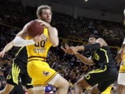 Arizona State's Mickey Mitchell (00) wins a loose ball against Oregon's Chandler Lawson (13) during the first half of an NCAA college basketball game Thursday, Feb. 20, 2020, in Tempe, Ariz.