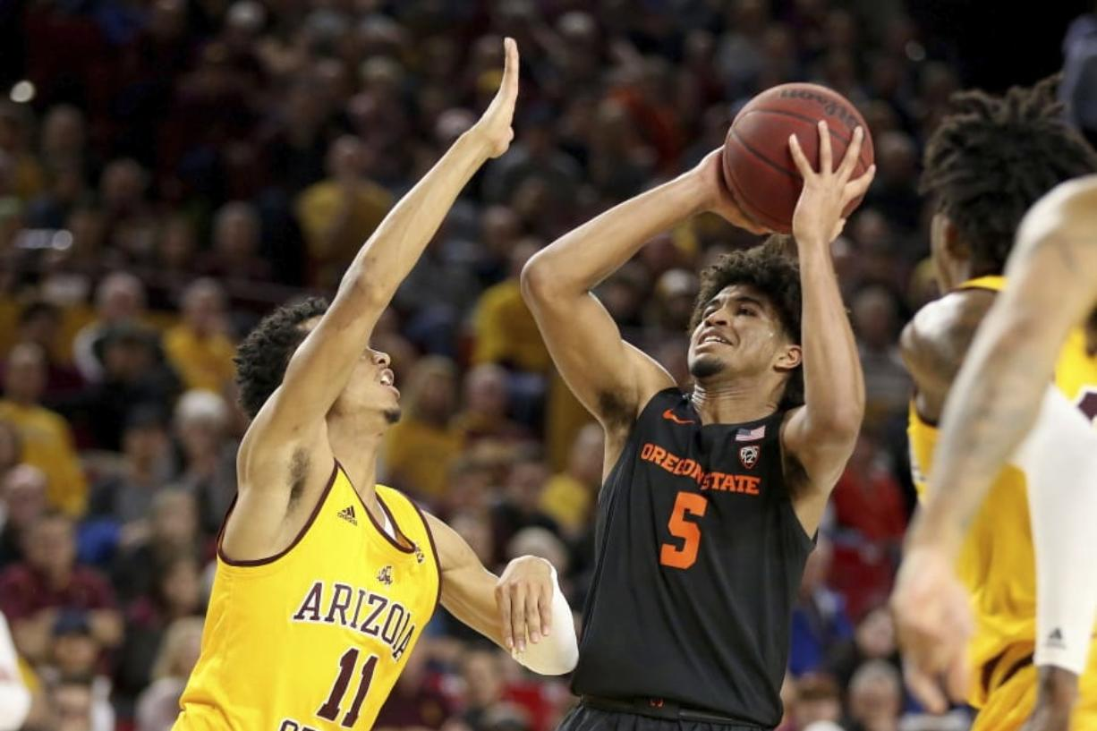 Oregon State's Ethan Thompson (5) looks to the basket against Arizona State's Alonzo Verge (11) during the first half of an NCAA college basketball game Saturday, Feb. 22, 2020, in Tempe, Ariz.