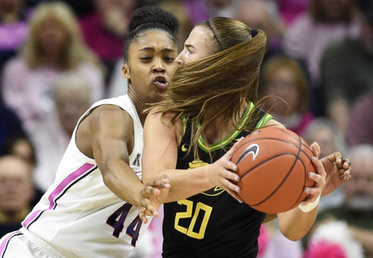 Connecticut's Aubrey Griffin, left, pressures Oregon's Sabrina Ionescu, right, in the first half of an NCAA college basketball game, Monday, Feb. 3, 2020, in Storrs, Conn. (AP Photo/Jessica Hill)