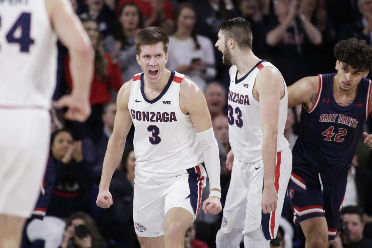 Gonzaga forwards Filip Petrusev (3) and Killian Tillie (33) celebrate after Petrusev scored during the second half of the team's NCAA college basketball game against Saint Mary's in Spokane, Wash., Saturday, Feb. 29, 2020. Gonzaga won 86-76.