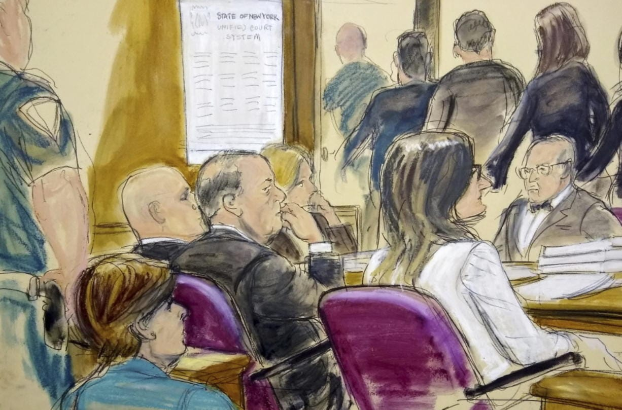 In this courtroom drawing, Harvey Weinstein, center, sits at the defense table surrounded by his attorneys as jurors file out of the courtroom after being told by the judge to go back and keep deliberating in Weinstein's rape case, Friday, Feb. 21, 2020, at Manhattan Supreme Court in New York. Earlier they sent out a note saying they were deadlocked on two charges. Attorney Gloria Allred, foreground left, is seated in the gallery behind Weinstein.
