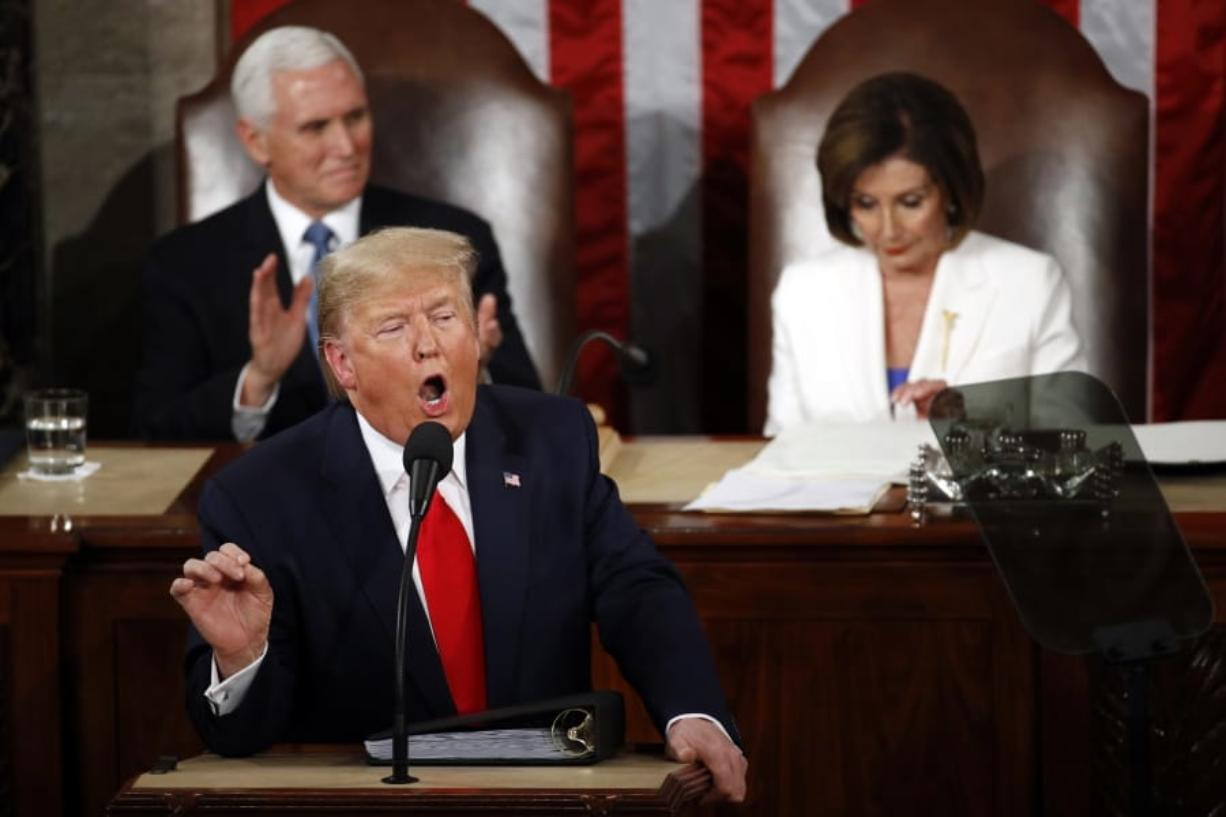 President Donald Trump delivers his State of the Union address to a joint session of Congress on Capitol Hill in Washington, Tuesday, Feb. 4, 2020, as Vice President Mike Pence ad House Speaker Nancy Pelosi of Calif., listen.
