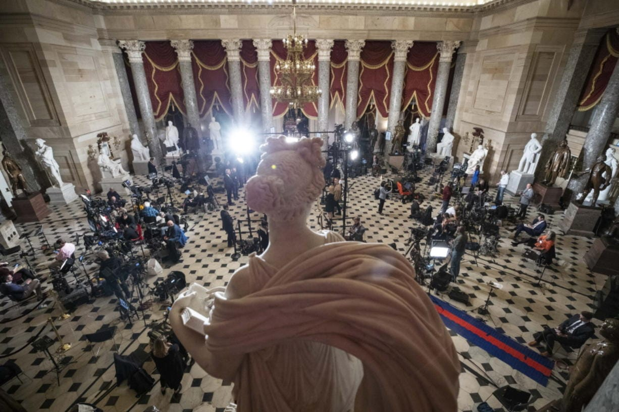 Statuary Hall, near the House floor, is set up for news media for the State of the Union address by President Donald Trump, on Capitol Hill, Tuesday, Feb. 4, 2020 in Washington.