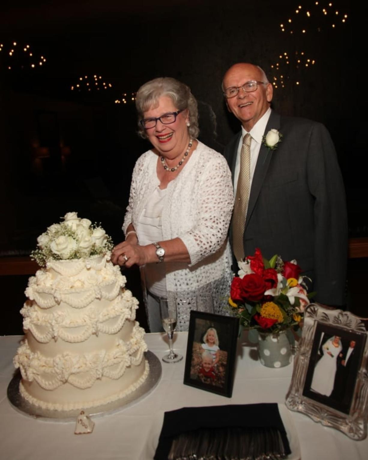 Mary Gammell and her husband, Ron, cutting the cake during their 50th wedding anniversary Aug. 13, 2016, in Tyler, Texas. Mary and Ron met when they were camp counselors and fell in love. They've now been married over 50 years. (iStock)