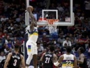 New Orleans Pelicans forward Zion Williamson (1) dunks the ball against the Portland Trail Blazers in the first half of an NBA basketball game in New Orleans, Tuesday, Feb. 11, 2020.