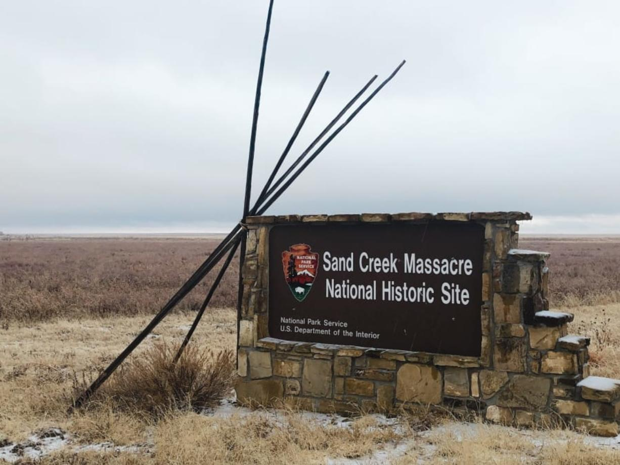 In this Dec. 27, 2019, photo, an entrance sign is shown at the Sand Creek Massacre National Historic Site in Eads, Colo. This quiet piece of land tucked away in rural southeastern Colorado seeks to honor the 230 peaceful Cheyenne and Arapaho tribe members who were slaughtered by the U.S. Army in 1864. It was one of worst mass murders in U.S. history.