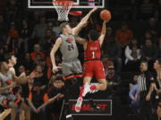 Oregon State's Kylor Kelley (24) blocks a shot by Utah's Timmy Allen (1) during the first half of an NCAA college basketball game in Corvallis, Ore., Thursday, Feb. 13, 2020.
