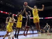 Southern California's Isaiah Mobley (15) grabs a rebound next to Washington State's Marvin Cannon during the second half of an NCAA college basketball game Saturday, Feb. 15, 2020, in Los Angeles.