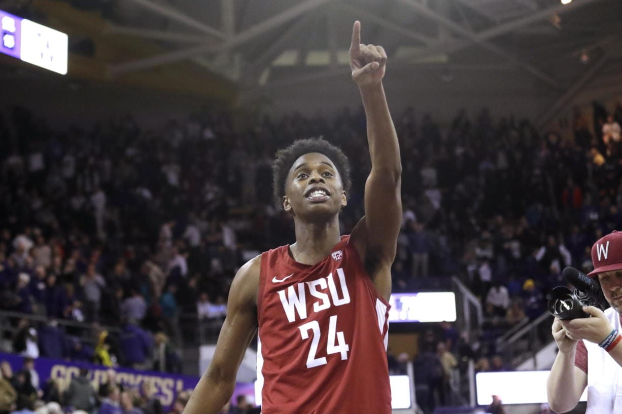 Washington State's Noah Williams points toward the stands after Washington State defeated Washington 78-74 in an NCAA college basketball game Friday, Feb. 28, 2020, in Seattle.
