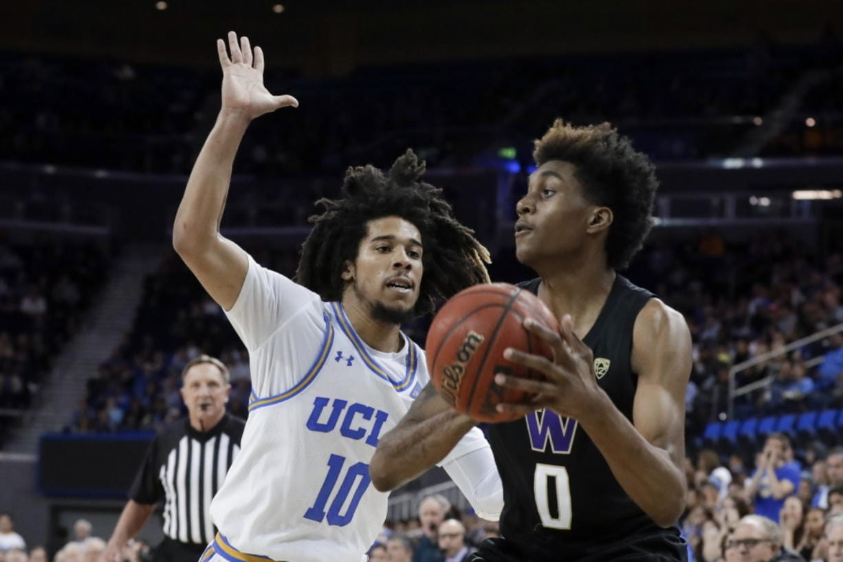 Washington forward Jaden McDaniels shoots around UCLA guard Tyger Campbell during the second half of an NCAA college basketball game in Los Angeles, Saturday, Feb. 15, 2020.