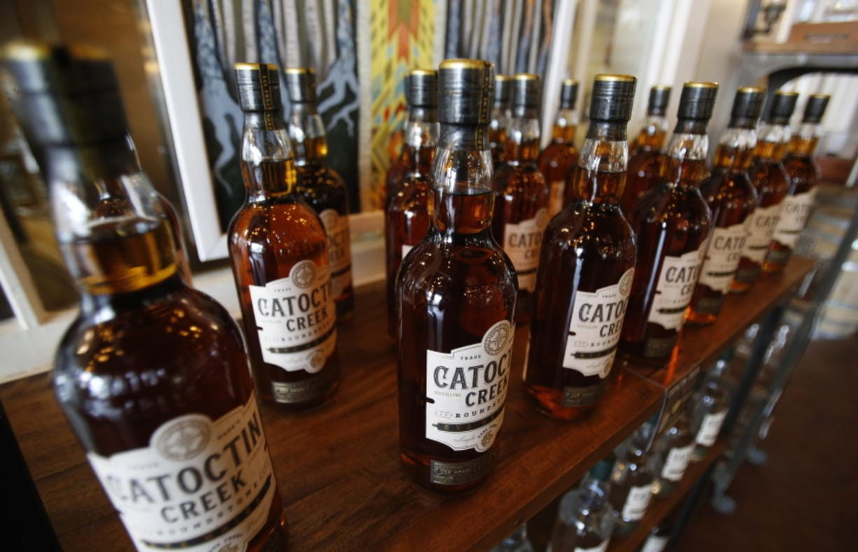 Catoctin Creek Distillery whiskey is on display in a tasting room June 20, 2018, in Purcellville, Va.