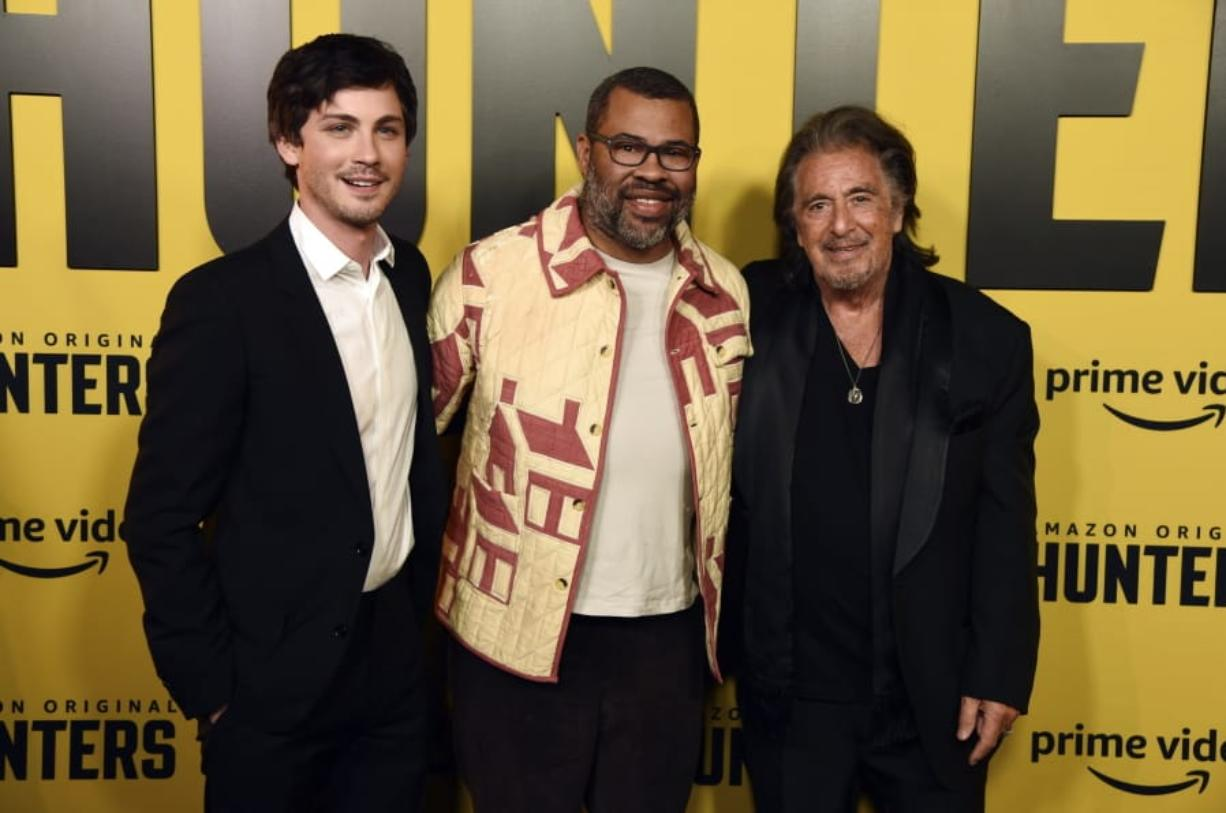 "Jordan Peele, center, executive producer of the Amazon Prime Video series ""Hunters,"" poses with cast members Logan Lerman, left, and Al Pacino at the premiere of the show at the Directors Guild of America, Wednesday, Feb. 19, 2020, in Los Angeles. (AP Photo/Chris Pizzello)"