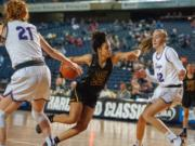 Hudson's Bay's Mahaila Harrison drives to the basket in a 3A round-of-12 game Wednesday at the Tacoma Dome.